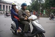 Hanoi, Vietnam, Family of four on a moped