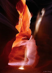 ANTELOPE CANYON,AZ-Sunlight and blowing sand from the surface adds to the surreal and abstract shapes and colorful hues of Antelope Canyon near Page, Arizona. Carved by millions of years of water and wind, the slot canyon is one of the most unique and beautiful geological wonders of the American West.