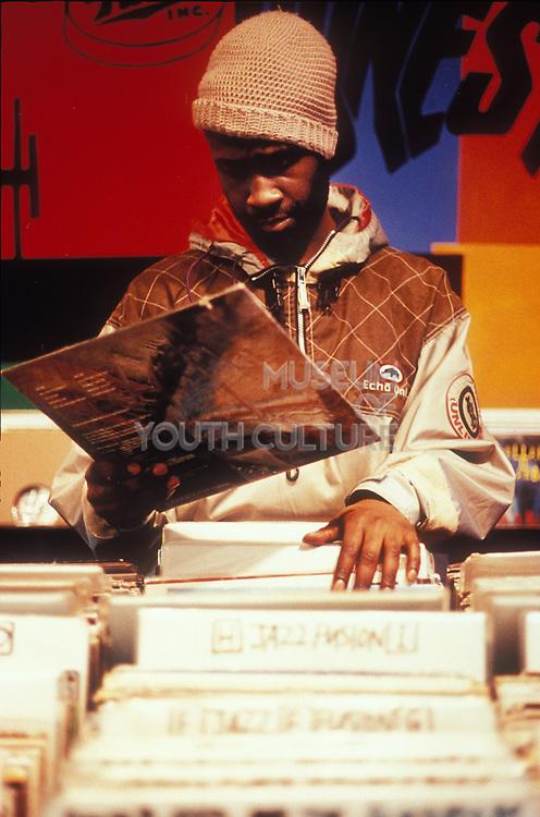 Man Looking through records, London, 1998