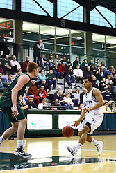 17 December 2011: Eliud Gonzalez moves into the lane during an NCAA mens division 3 basketball game between the Washington University Bears and the Illinois Wesleyan Titans in Shirk Center, Bloomington IL