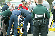 (gang restraint)  --  A combination of Walla Walla Police officers, Walla Walla County Deputy Sherriffs and paramedics attempt to restrain a screaming and fighting victim of a reported gang fight in the 600 block of North Roosevelt Street Friday evening.        (5/2/08)        MZ Photo