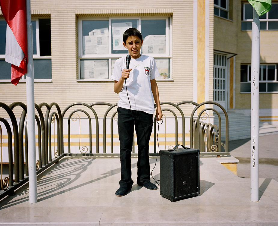 A boy at a primary school stands on an outdoor podium during a school assembly in Esfahan, Esfahan province on 22nd October 2007..Portraits of Iranians born since the 1979 revolution..