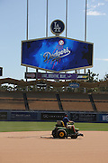 LOS ANGELES, CA - JULY 13:  A groundskeeper works on the infield before the Los Angeles Dodgers game against the San Diego Padres at Dodger Stadium on Sunday, July 13, 2014 in Los Angeles, California. The Dodgers won the game 1-0. (Photo by Paul Spinelli/MLB Photos via Getty Images)