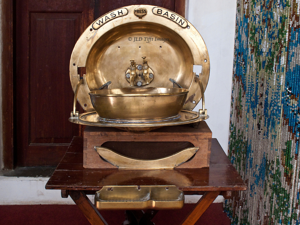 Brass wash basin with two taps  displayed at Darbar Hall Museum, Junagadh, Gujarat.