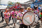 13 APRIL 2013 - BANGKOK, THAILAND:  Marching bands lead a parade for Songkran on Khao San Road in Bangkok. Songkran is celebrated in Thailand as the traditional New Year's Day from 13 to 16 April. The date of the festival was originally set by astrological calculation, but it is now fixed. If the days fall on a weekend, the missed days are taken on the weekdays immediately following. Songkran is in the hottest time of the year in Thailand, at the end of the dry season and provides an excuse for people to cool off in friendly water fights that take place throughout the country. Songkran has been a national holiday since 1940, when Thailand moved the first day of the year to January 1.   PHOTO BY JACK KURTZ