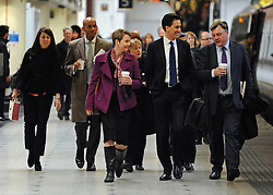 © Licensed to London News Pictures. 16/03/2012. London, UK. (left to right) Rachel Reeves MP,  Chuka Umunna MP, Yvette Cooper MP, Angela Eagle MP, Ed Miliband MP, Ed Balls MP. Leader of the Labour Party, Ed Miliband and members of his Shadow Cabinet travel to Labour's Youth Conference in Coventry this morning, 16 March 2012, by train from London Euston Station. Photo credit : Stephen SImpson/LNP
