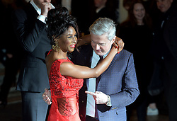 Sinitta and Louis Walsh embrace as they arrive at the show.<br /> Celebrities attend the opening night of new West End show 'I Can't Sing' at The London palladium, London, UK. Wednesday, 26th March 2014. Picture by Ben Stevens / i-Images