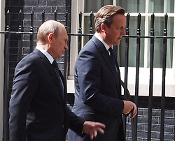 Prime Minister David Cameron with Russian President  Vladimir Putin outside 10 Downing Street in London, Sunday, 16th June 2013<br /> Picture by Max Nash / i-Images