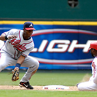 17 May 2006:   Atlanta Braves shortstop Edgar Renteria (11) receives the throw as Washington Nationals shortstop Cristian Guzman (15) steals second base in the 8th inning.  The Nationals defeated the Braves 4-3 at RFK Stadium in Washington, D.C.