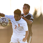 Ryota Matsuura blocks the ball from an unidentified Santa Ana defender in Big West Soccer action at Santa Ana College.<br /> <br /> @2016 at Rick May Photography