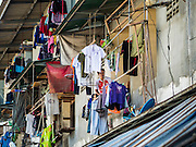 """11 JUNE 2015 - MAHACHAI, SAMUT SAKHON, THAILAND:  A Burmese migrant worker on the balcony of his apartment in Mahachai. Labor activists say there are about 200,000 migrant workers from Myanmar (Burma) employed in the fishing and seafood industry in Mahachai, a fishing port about an hour southwest of Bangkok. Since 2014, Thailand has been a Tier 3 country on the US Department of State Trafficking in Persons Report (TIPS). Tier 3 is the worst ranking, being a Tier 3 country on the list can lead to sanctions. Tier 3 countries are """"Countries whose governments do not fully comply with the minimum standards and are not making significant efforts to do so."""" After being placed on the Tier 3 list, the Thai government cracked down on human trafficking and has taken steps to improve its ranking on the list. The 2015 TIPS report should be released in about two weeks. Thailand is hoping that its efforts will get it removed from Tier 3 status and promoted to Tier 2 status.       PHOTO BY JACK KURTZ"""
