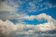 Fluffy white clouds in a blue sky.