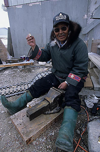 Canada, Nunavut Territory, Town elder working in town of Igloolik.