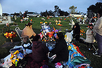 In a touching final celebration of All Soul's Day on Saturday night, hundreds of congregants came to Queen of Heaven Cemetery in Salinas to attend mass, offer their prayers, and as dusk fell, participate in a candlelight procession.  Friends and family members sat by the graves of loved ones, many of which were decorated with traditional Day of the Dead marigolds, photographs of the departed, and things that were their favorites in life.