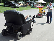David W. Smith/ Daily News<br /> Tom Hunt from Franklin OH, takes a picture of Al Karlowitsch from Hickory, NC,  on his motorized recliner during the Hot Rod Reunion Thursday at Beech Bend Campground. Driving by on his motorized lawnchair is Tom Schmoyer from Macungie, PA.