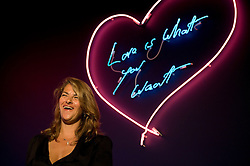 """© licensed to London News Pictures. London, UK. 16/05/2011. Tracey Emin poses underneath her title piece """"Love is What You Want""""  at a photo call for the preview of Tracey Emin's new exhibition """"Love is What You Want"""" at Hayward Gallery, Southbank, London today (16/05/2011).  Photo credit should read Ben Cawthra..."""