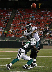 Sept 3, 2009; East Rutherford, NJ, USA;   Philadelphia Eagles quarterback Michael Vick (7) is hit by New York Jets cornerback James Ihedigbo (44) during the second half at Giants Stadium.  The Jets defeated the Eagles 38-27.