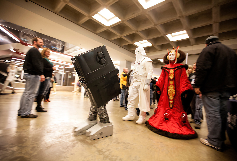 Phil Glover (Gonk) and fellow members of the 501st Legion Central Garrison walk amongst fans at Star Wars night at the Timberwolves game at Target Center in Minneapolis December 15, 2015.