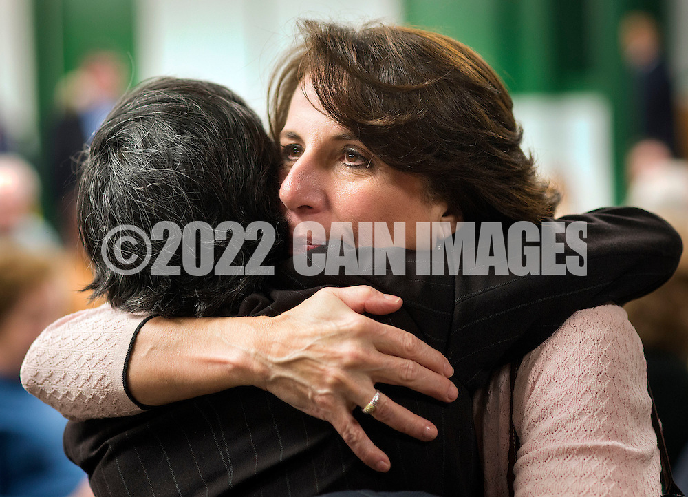 Assemblywoman Pam Lampitt (right) hugs Farhat Biviji during an interfaith prayer service at Our Lady of Perpetual Health Thursday, March 2, 2017 in Maple Shade, New Jersey. (Photo by William Thomas Cain)