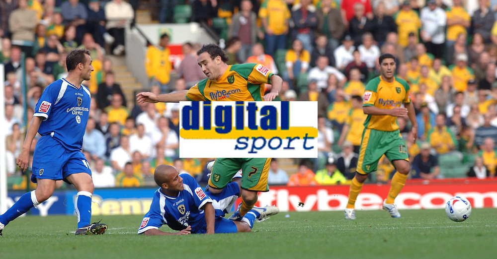 Photo: Ashley Pickering.<br />Norwich City v Cardiff City. Coca Cola Championship. 21/10/2006.<br />Cardiff's  James Chambers (blue) tackles Norwich's Lee Croft.