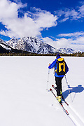 Backcountry skier under Mount Moran, Grand Teton National Park, Wyoming