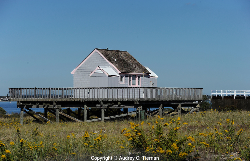 Westhampton Beach, NY: Wednesday, Oct. 13, 2010-- A charming beach cottage precariously perched at the water's edge.  © Audrey C. Tiernan
