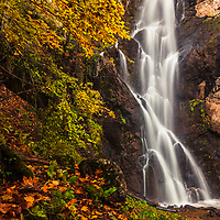 Silky waterfall in the autumn forest