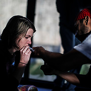 """Mallory Branch, who lost her brother to opioid addiction, smokes the venom bufo alvarius, a rare toad found in the Mexican desert, during a """"healing ceremony""""  under the watch of """"shaman/sitter"""" named Madhu in Lexington on Thursday, October 19, 2017."""