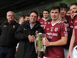 Mayo Bord na nOg Chairman Con Moynihan presenting the Minor A championship trophy to Balla captain Patrick McLouglin.<br />Pic Conor McKeown