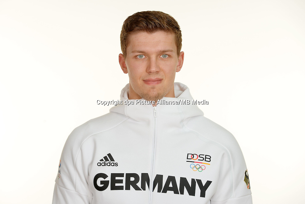 Christian Dissinger poses at a photocall during the preparations for the Olympic Games in Rio at the Emmich Cambrai Barracks in Hanover, Germany. July 27, 2016. Photo credit: Frank May/ picture alliance. | usage worldwide