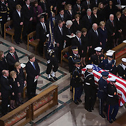 Pres. Bush and First Lady Laura Bush attend funeral services for former Pres. Gerald Ford at the National Cathedral in Washington, Tuesday, Jan. 2, 2007.  The Ford family is at lower left.  Other side of aisle left to right (Front Row) Pres. Bush, First Lady Laura Bush, VP Cheney, wife Lynne Cheney, former Pres. Jimmy Carter, wife Rosalynn Carter, Nancy Reagan. (2nd Row) Pres. George H. W. Bush, wife Barbara, daughter Doro Koch, Pres. Clinton, Sen. Hillary Clinton (D-NY), daughter Chelsea Clinton, Sec. of State Rice.<br /> <br /> Photo by Khue Bui
