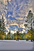USA, Idaho, Valley County, Donnelly, Tamarack Resort, Sunset over the Forest