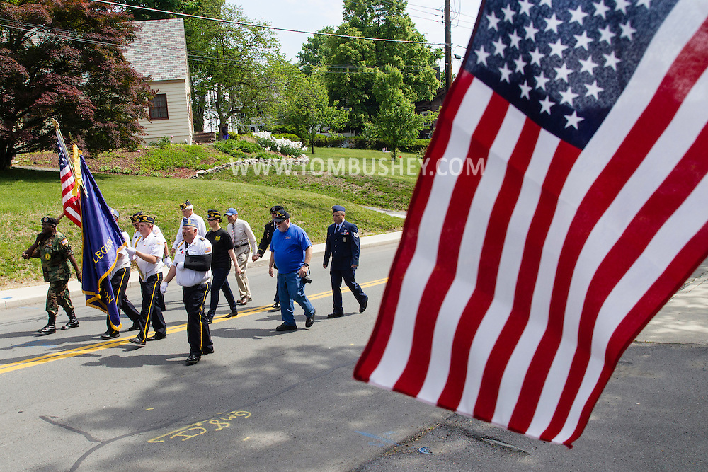 Middletown, New York - Marchers in the Middletown-Town of Wallkill Memorial Day parade head up Route 211 on May 25, 2015.