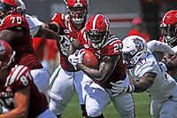 Wolfpack running back Reggie Gallaspy breaks a tackle as he heads up field against JMU.