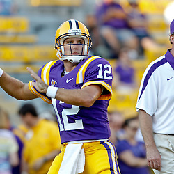 September 10, 2011; Baton Rouge, LA, USA;  LSU Tigers quarterback Jarrett Lee (12) with quarterbacks coach Steve Kragthorpe prior to kickoff of a game against the Northwestern State Demons at Tiger Stadium.  Mandatory Credit: Derick E. Hingle