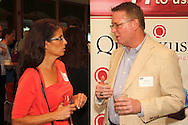 Danielle Deramo of Just Say It! (left) and Rusty Olmes of Pathfinder Solutions, Ltd. during a Dayton Area Chamber of Commerce Business After Hours at the NCR Country Club in Kettering, Wednesday, July 25, 2012.  The Chamber will hold the 2012 Chamber Challenge, their 20th annual golf tournament and silent auction, at the NCR Country Club in September.