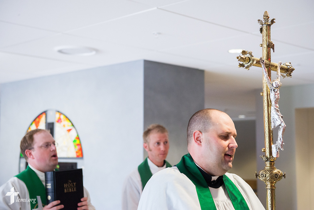 The Rev. Benjamin Ball, senior pastor of St. Paul Lutheran Church in Hamel, Ill., carries the processional cross during the opening worship of the 2014 Institute on Liturgy, Preaching and Church Music on Monday, July 28, 2014, at St. John Lutheran Church next to Concordia University, Nebraska, in Seward, Neb. LCMS Communications/Erik M. Lunsford