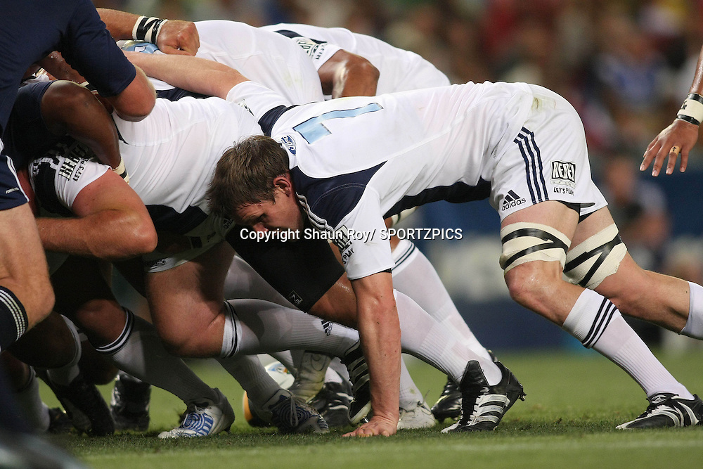 CAPE TOWN, SOUTH AFRICA - 28 February 2009: Josh Blackie scrums during the Super 14 match between the Vodacom Stormers and the Blues held at Newlands Stadium in Cape Town. Photo by: Shaun Roy/ SPORTZPICS