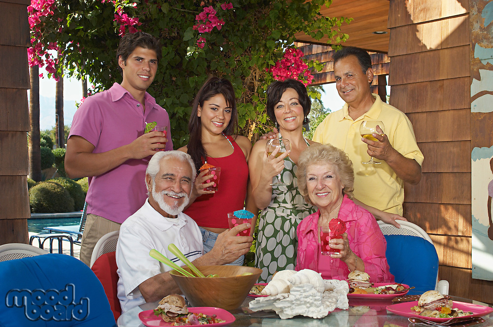 Family with drinks on porch