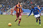 Bradford City forward Shay McCartan (14)  and Oldham Athletic and new loanee Signing, Moimbe Pens (3)  during the EFL Sky Bet League 1 match between Oldham Athletic and Bradford City at Boundary Park, Oldham, England on 3 February 2018. Picture by Mark Pollitt.