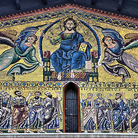 """San Frediano Church Byzantine Mosaic in Lucca, Italy<br /> This gold leaf Byzantine mosaic on the front of the San Frediano Church deserves a close up.  Called the """"Ascension of Christ the Saviour,"""" it was designed by Berlinghiero Berlinghieri in the 13th century.  The angels greet the Lord into heaven with images of the Twelve Apostles below Him.  It comes alive with beauty in the direct sunlight."""