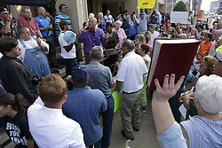 Crowds gathered outside the Federal Building in Ashland as a hearing in Judge David Bunning's court on charges of contempt against Rowan County Clerk Kim Davis for not issuing marriage licenses, Thursday, Sept. 03, 2015 at Carl D. Perkins Federal Building in Ashland.  Photo by Jonathan Palmer, Special to the CJ