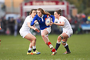 French scrum half Bourdon Pauline breaks 2 English tackles to score a try in the second half during the Women's 6 Nations match between England Women and France Women at the Keepmoat Stadium, Doncaster, England on 10 February 2019.