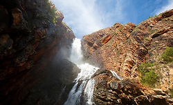 Water cascades down Turtle Falls in Dugong Bay in the Kimberley wet season.