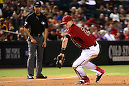 PHOENIX, AZ - JULY 06:  Jake Lamb #22 of the Arizona Diamondbacks fields a ground ball during the fourth inning of the MLB game San Diego Padres at Chase Field on July 6, 2016 in Phoenix, Arizona.  (Photo by Jennifer Stewart/Getty Images)