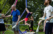 Luella Shapiro, center right, coaches Elise Jensen on aerial silks during the Makeshift Festival at Tenney Park in Madison, Wisconsin, Sunday, Aug. 12, 2018.