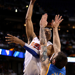 Mar 19, 2011; Tampa, FL, USA; Florida Gators forward Alex Tyus (23) shoots over UCLA Bruins forward Reeves Nelson (22) during first half of the third round of the 2011 NCAA men's basketball tournament at the St. Pete Times Forum.  Mandatory Credit: Derick E. Hingle