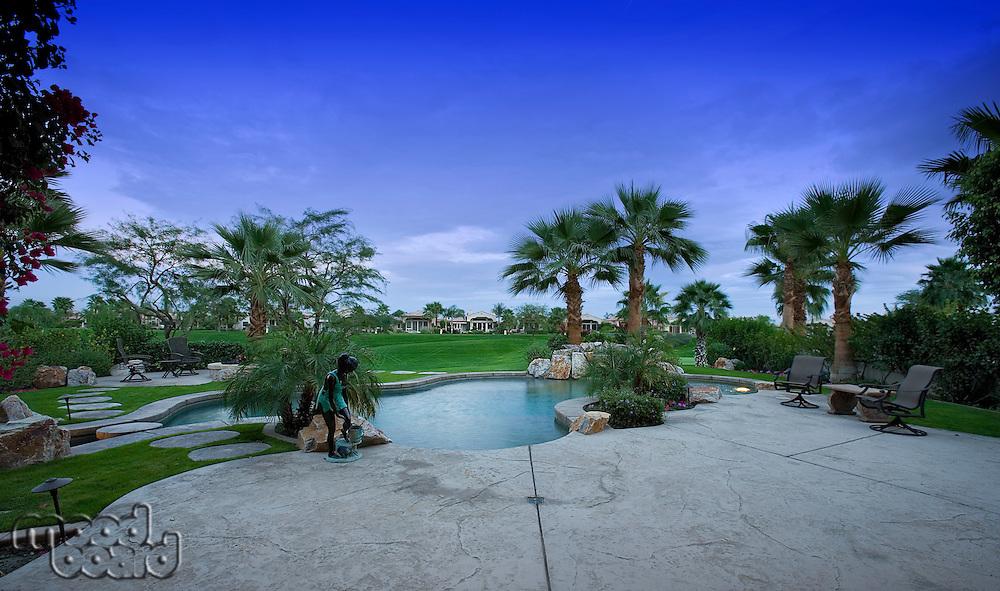 Swimming pool in backyard of luxury home