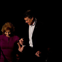ORLANDO, FL -- September 22, 2011 -- Republican presidential candidate Gov. Rick Perry helps wis wife, Anita, up the stairs during the Florida P5 Faith and Freedom Coalition Kick-Off at the Rosen Centre Hotel in Orlando, Fla., on Thursday, September 22, 2011.  Nine Republican presidential candidates congregated for a Fox News / Google Debate.   (Chip Litherland for The New York Times)