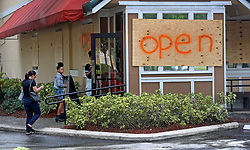 September 7, 2017 - Coral Springs, FL, USA - Although they had plywood on the windows, the Outback Steakhouse on Riverside Drive in Coral Springs was still open for business. Mike Stocker, South Florida Sun-Sentinel  (Credit Image: © Sun-Sentinel via ZUMA Wire)